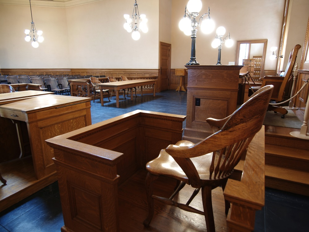 Empty courtroom, focused on witness stand