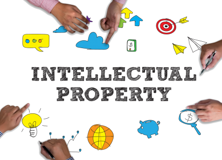 Idea icons with hands pointing and the words, Intellectual Property